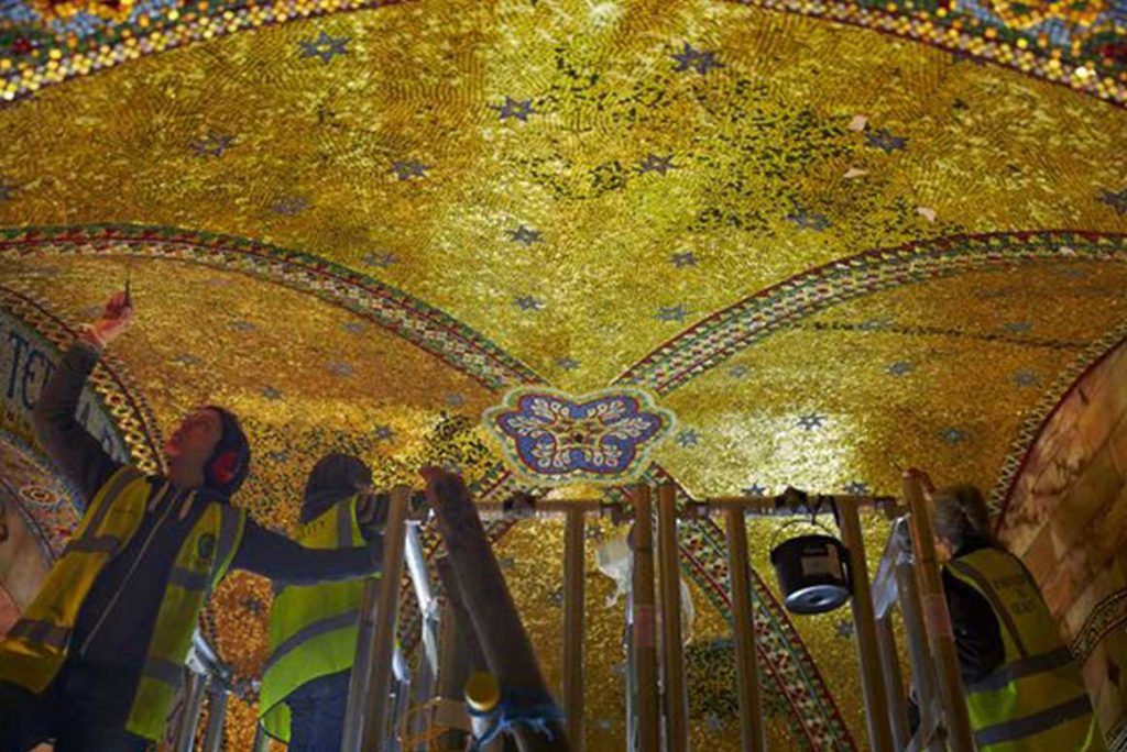 Restorers working on the golden ceiling of the Fitzrovia Chapel