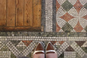 Two shoes on Fitzrovia Chapel mosaic floor